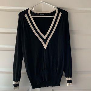 Black and white V neck sweater.